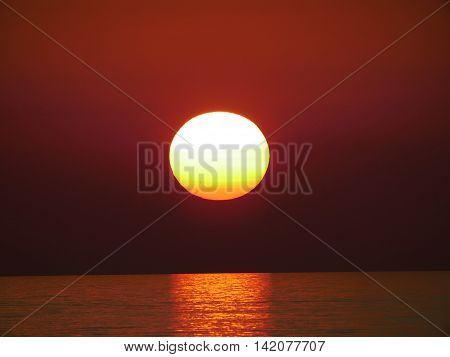 Sunrise over Lake Michigan with visible sunspots.