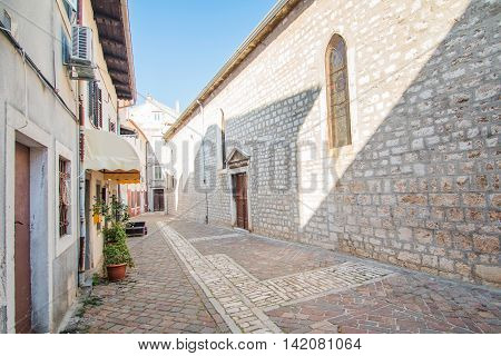 Street and old houses in old town in Cres, Croatia, Mediterranean ambient