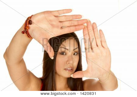 Woman Framing Scene With Her Hands