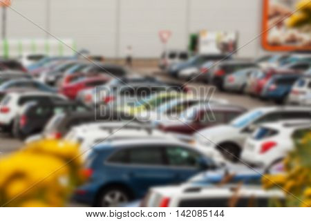 Parking lot next to shopping center. Do not leave documents and valuables in the Glove compartment, or in the car , blur