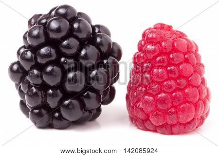 raspberries and blackberries isolated on white background.