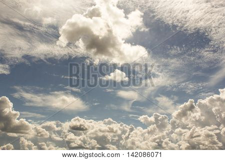 Scattered cumulus clouds. Cumulus and cirrus clouds illuminated by the sun.