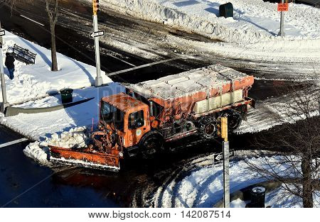 New York City - January 24 2016: NYC Sanitation Department truck plowing snow on Broadway at West 143rd Streets in Hamilton Heights  *