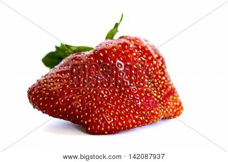 Strange red stawberry isolated on white background