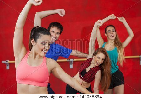 Woman Practicing Zumba With Friends