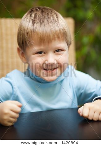 Little Boy With Roguish Smile