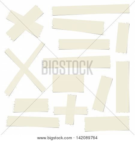 Pieces of brown different size sticky, adhesive masking tape are on white background.