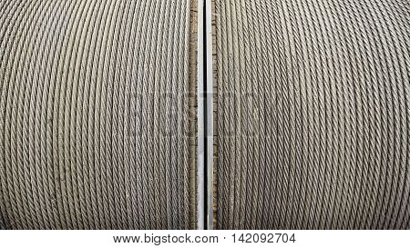 Steel winching cable, an abstract industrial background.