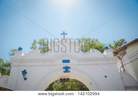 Christian Wooden Cross Atop The Church Color And Blue Sky With Clouds