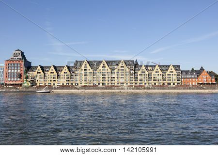 Old warehouses at the Rhine river in Cologne now converted into luxury apartment buildings. North Rhine-Westphalia Germany