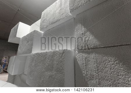Large blocks of polystyrene. Polystyrene insulation boards. Polystyrene plates warehouse. Polystyrene Stack