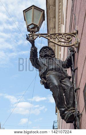 Kiev Uzhgorod - April 27 2016: Lamplighter monument in bronze on the wall