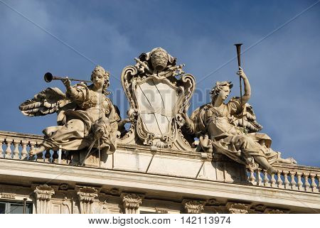 Pope Clement XII (Corsini Family) emblem between angels with trumpets in Quirinale Square in Rome designed by architect Ferdinando Fuga in the 18th century