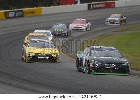 Long Pond, PA - Aug 01, 2016: Denny Hamlin (11) battles for position during the Pennsylvania 400 at the Pocono Raceway in Long Pond, PA.