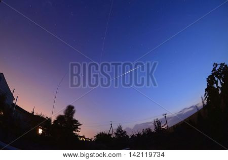 Iridium 13 flare and ISS treck in the night sky in the countriside near Kiev.August 9 ,2016 in Kiev, Ukraine