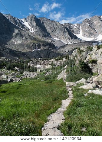 National park Service rock trail up to Glass Lake and Sky Pond in Rocky Mountain national park with Taylor Glacier