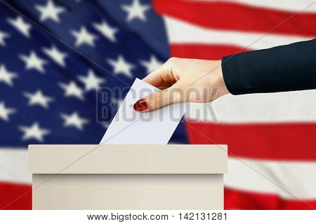 women hand casting a vote with american flag background
