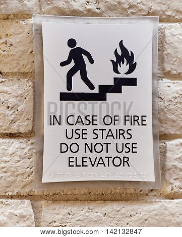 In Case of Fire Use Stairs Do not use Elevator warning sign
