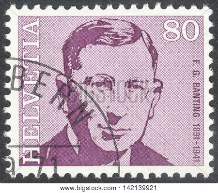 MOSCOW RUSSIA - CIRCA APRIL 2016: a post stamp printed in SWITZERLAND shows a portrait of Frederick Banting the series
