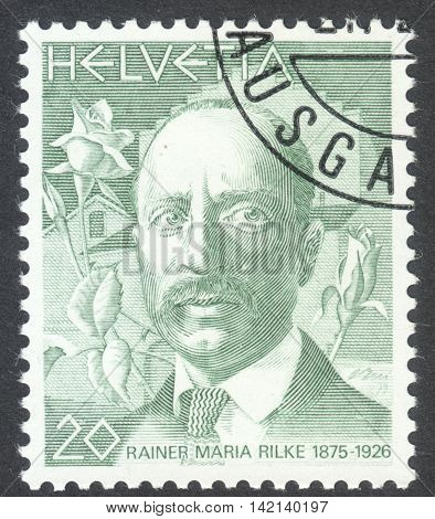 MOSCOW RUSSIA - CIRCA APRIL 2016: a post stamp printed in SWITZERLAND shows a portrait of Rainer Maria Rilke the series