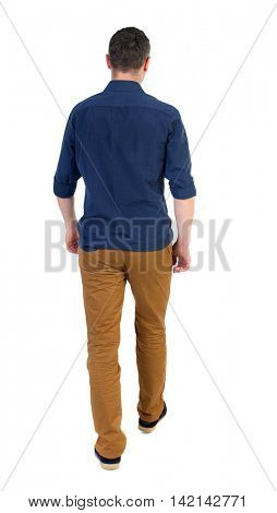 Back view of going  handsome man. walking young guy . Rear view people collection.  backside view of person.  Isolated over white background. a man in a blue shirt with the sleeves rolled out into the