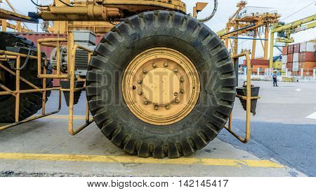 The tractor tire on white background .