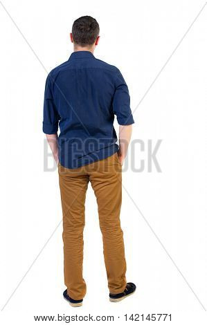 Back view of man . Standing young guy. Rear view people collection.  backside view of person.  Isolated over white background.a man in a blue shirt with the sleeves rolled up, standing with his hands