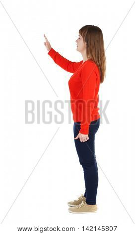 Back view of  pointing woman. beautiful girl. Rear view people collection.  backside view of person.  Isolated over white background. The girl in the red sweater is left side by pressing the index