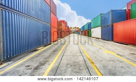 Business and logistics. Cargo transportation and storage. Equipment containers shipping and the traffic road with the yellow line perspective.