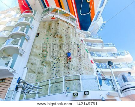 Barcelona Spain - September 12 2015: The cruise ship Allure of the Seas owned Royal Caribbean International. The free attraction - climbing wall at the ship