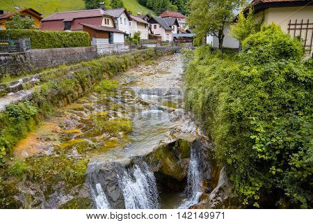 Beautiful mountains city with mountains river in summer