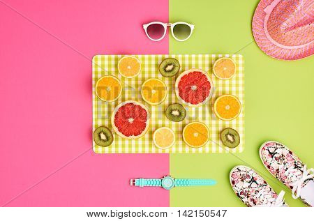 Fashion. Summer Clothes Accessories fashion set. Tropical Fruit Citrus Orange Lime. Fashion woman Glamor Wrist Watches Trendy Sunglasses Gumshoes. Stylish girl Outfit. Fashion creative art concept