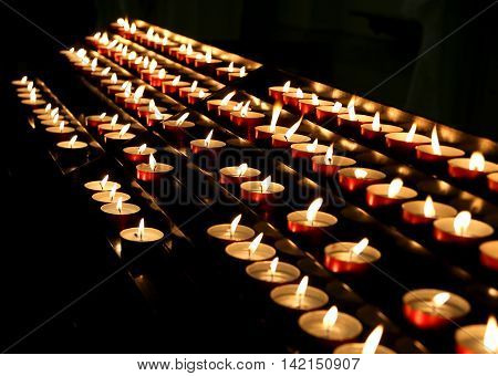 Series Of Candles Lit With Flickering Flame