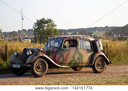 WESTERNHANGER, UK - JULY 20: A vintage Citroen automobile drives around the perimeter road of the show arena at the War & Peace Revival show on July 20, 2016 in Westernhanger