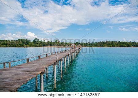 Jetty to a tropical beachJetty to a tropical beachJetty to a tropical beach with blue sky background