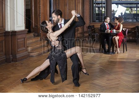 Tango Dancers Performing While Couple Dating In Restaurant