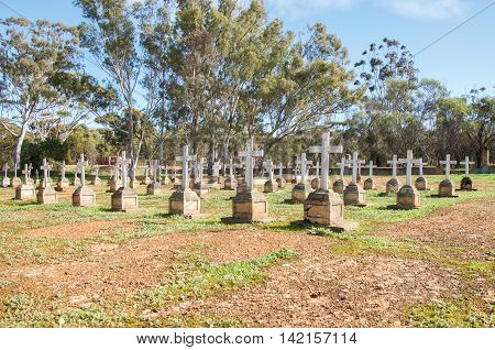 NEW NORCIA,WA,AUSTRALIA-JULY 15,2016: Old cemetery with rows of headstones in peaceful treed landscape in the monastic town of New Norcia, Western Australia.