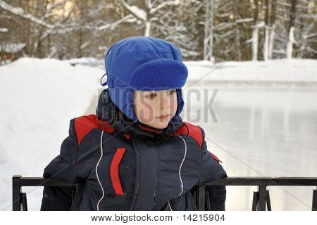 Sad Little Boy At The Ice Rink
