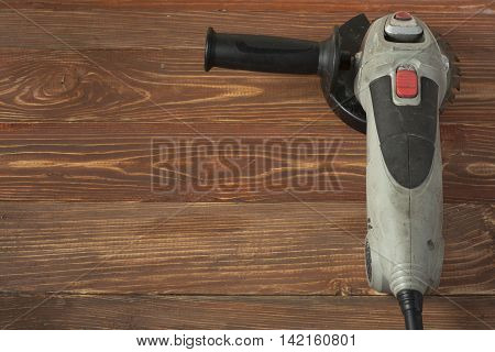 Electric circular saw on wood background. Copy space for text.