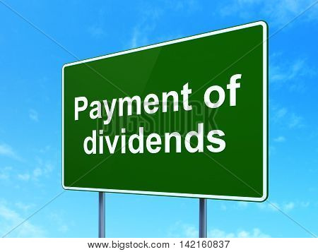 Money concept: Payment Of Dividends on green road highway sign, clear blue sky background, 3D rendering