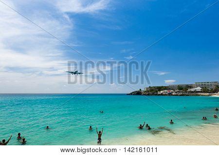 airplane landing over the sea beach of Maho bay Caribbean