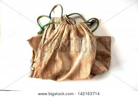 Old Cotton drawstring bag on white background