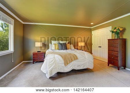 Gray Bedroom Interior With Chest Of Drawers And Fresh Flowers