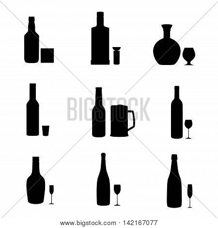 Vector set of black silhouette alcohol bottles with glasses. Alcohol drinks glasses and bottles icons.