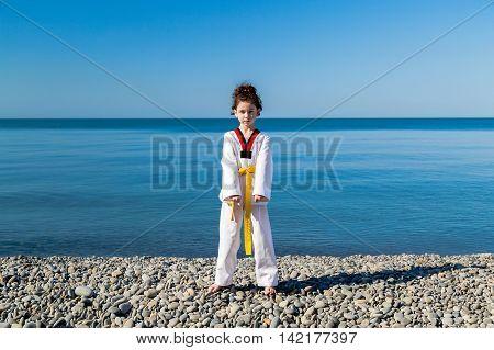 The girl training on the beach: Taekwondo sports