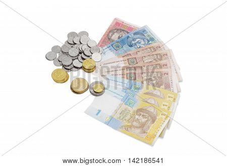 Some modern banknotes and coins of Ukrainian hryvnia different denominations on a light background