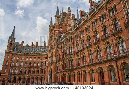 ST PANCRAS, LONDON, UK - JULY 21, 2016. The exterior and curved facade of The St Pancras Renaissance Hotel in London which is a five star, luxury establishment and popular tourist destination.