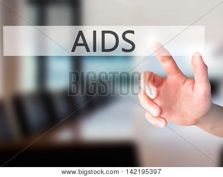 Aids - Hand Pressing A Button On Blurred Background Concept On Visual Screen.