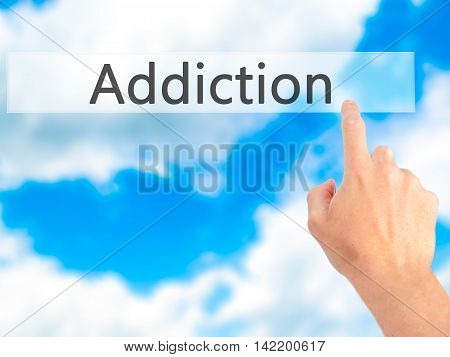 Addiction - Hand Pressing A Button On Blurred Background Concept On Visual Screen.