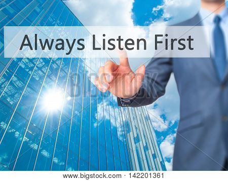 Always Listen First -  Businessman Press On Digital Screen.